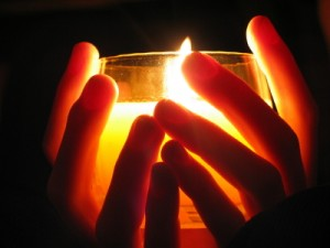 holding flame candle light