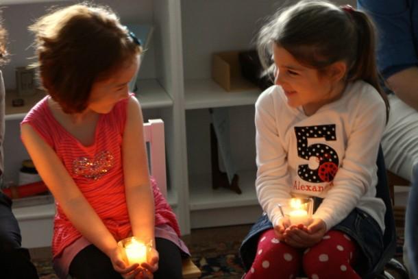 Children lights candles girls