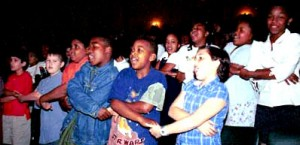 Children at a Library of Congress lifelong readers event sing We Shall Overcome.
