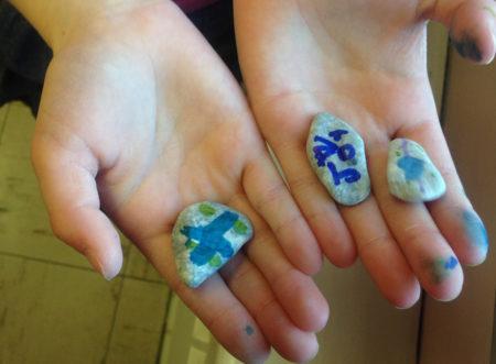 Hands rocks paint