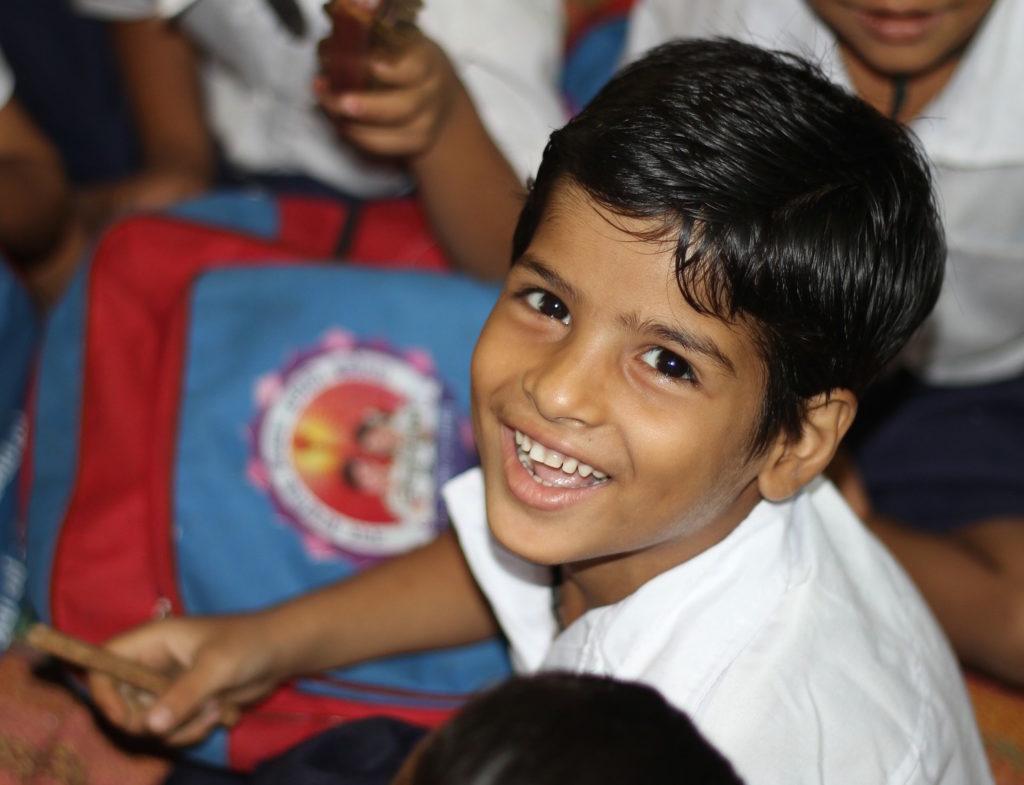 boy laughing school