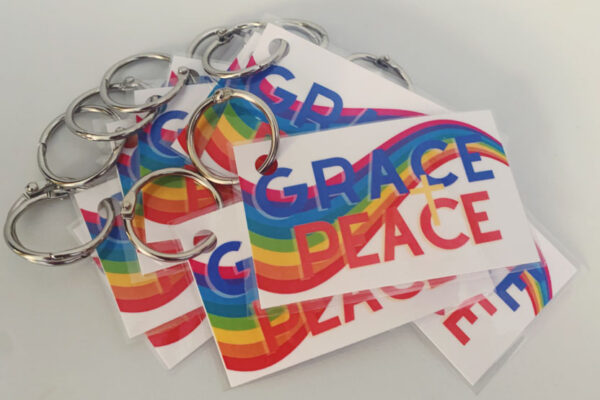 Cards with rainbow flag and words Grace + Peace