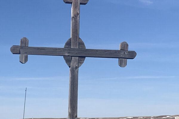 Wooden cross agains blue sky.